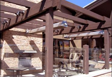 infrared-patio-heaters-under-pergola-with-fireplace